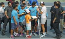 Spain's Rafael Nadal signs autographs for Indian fans at a promotional event in New Delhi, India, Thursday, Dec. 10, 2015. Nadal, who plays for Indian Aces in the International Professional Tennis League (IPTL), is in India to play a leg of the league. (AP Photo/Altaf Qadri)