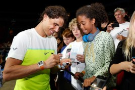 SYDNEY, AUSTRALIA - JANUARY 11: Rafael Nadal signs autographs for fans after the FAST4Tennis exhibition doubles match between Rafael Nadal and Gael Monfils of The World Team and Lleyton Hewitt and Nick Kyrgios of Australia Team at Allphones Arena on January 11, 2016 in Sydney, Australia. (Photo by Zak Kaczmarek/Getty Images)