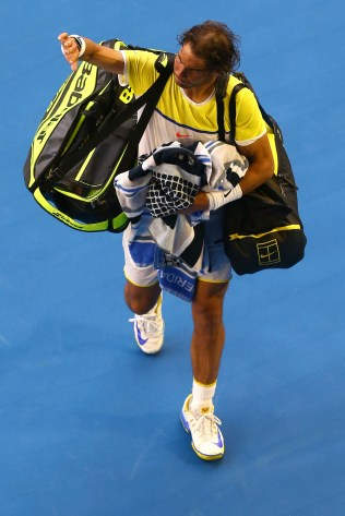 MELBOURNE, AUSTRALIA - JANUARY 19: Rafael Nadal of Spain walks off court after losing his first round match against Fernando Verdasco of Spain during day two of the 2016 Australian Open at Melbourne Park on January 19, 2016 in Melbourne, Australia. (Photo by Ryan Pierse/Getty Images)