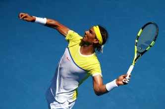 MELBOURNE, AUSTRALIA - JANUARY 19: Rafael Nadal of Spain serves in his first round match against Fernando Verdasco of Spain during day two of the 2016 Australian Open at Melbourne Park on January 19, 2016 in Melbourne, Australia. (Photo by Ryan Pierse/Getty Images)