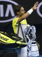 Rafael Nadal of Spain waves as he leaves Rod Laver Arena following his loss to compatriot Fernando Verdasco in their first round match at the Australian Open tennis championships in Melbourne, Australia, Tuesday, Jan. 19, 2016.(AP Photo/Mark Baker)