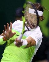 Rafael Nadal of Spain returns the ball to Pablo Carreno Busta of Spain during their Qatar Open men's single tennis match in Doha, Qatar, January 5, 2016. REUTERS/Ibraheem Al Omari
