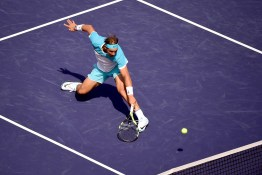 INDIAN WELLS, CA - MARCH 19: Rafael Nadal of Spain hits a backhand volley in his loss to Novak Djokovic of Serbia during day thirteen of the 2016 BNP Parisbas Open at Indian Wells Tennis Garden on March 19, 2016 in Indian Wells, California. (Photo by Harry How/Getty Images)