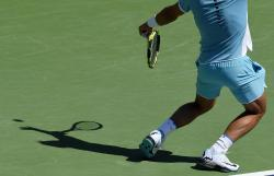 Rafael Nadal, of Spain, serves to Kei Nishikori, of Japan, during their quarterfinal match at the BNP Paribas Open tennis tournament, Friday, March 18, 2016, in Indian Wells, Calif. (AP Photo/Mark J. Terrill)