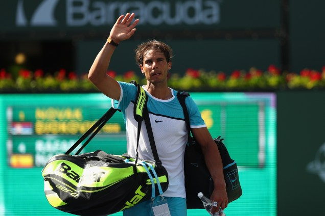 INDIAN WELLS, CA - MARCH 19: Rafael Nadal of Spain leaves the court after his loss in his match against Novak Djokovic of Serbia in the semi finals during day thirteen of the BNP Paribas Open at Indian Wells Tennis Garden on March 19, 2016 in Indian Wells, California. (Photo by Julian Finney/Getty Images)