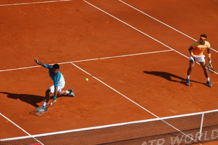 Fernando Verdasco (L) of Spain makes a return as Rafael Nadal (R) of Spain looks on in the doubles against Philipp Kohlschreiber of Germany and Viktor Troicki of Serbia during day two of the Monte Carlo Rolex Masters at Monte-Carlo Sporting Club on April 11, 2016 in Monte-Carlo, Monaco. (April 10, 2016 - Source: Michael Steele/Getty Images Europe)