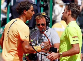Tennis - Monte Carlo Masters - Monaco, 15/04/2016. Rafael Nadal of Spain (L) shakes hand with Stan Wawrinka of Switzerland following their match. REUTERS/Eric Gaillard