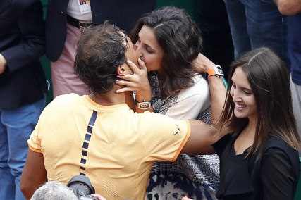 Photographers take pictures as Spain's Rafael Nadal kisses his girlfriend Xisca Perello after winning against France's Gael Monfils in the final tennis match at the Monte-Carlo ATP Masters Series Tournament in Monaco on April 17, 2016. Nadal defeated Monfils 7-5, 5-7, 6-0 to win a record ninth title at the Monte Carlo Masters. AFP PHOTO / VALERY HACHE / AFP / VALERY HACHE(April 17, 2016 - Source: AFP)