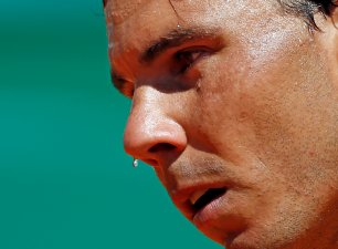 Tennis - Monte Carlo Masters - Monaco, 13/04/2016. A drop of sweat falls from the face of Rafael Nadal of Spain during his match against Aljaz Bedene of Britain. REUTERS/Eric Gaillard