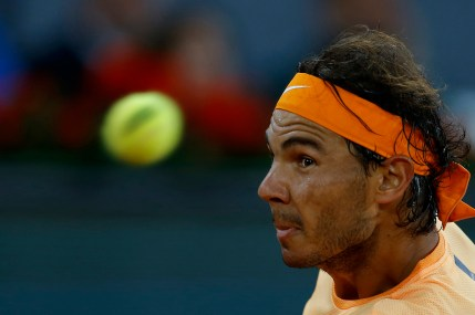 Rafael Nadal, from Spain, eyes the ball as he plays against Joao Sousa, from Portugal, during a Madrid Open tennis tournament match in Madrid, Spain, Friday, May 6, 2016. Nadal won 6-0, 4-6 and 6-3. (AP Photo/Francisco Seco)