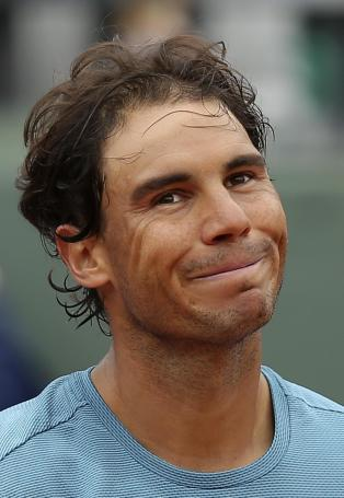 Spain's Rafael Nadal smiles after defeating Australia's Sam Groth of the French Open tennis tournament at the Roland Garros stadium, Tuesday, May 24, 2016 in Paris. Nadal won 6-1, 6-1, 6-21. (AP Photo/David Vincent)
