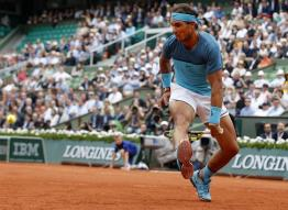 Spain's Rafael Nadal returns the ball between his legs as he plays Argentina's Facundo Bagnis during their second round match of the French Open tennis tournament at the Roland Garros stadium, Thursday, May 26, 2016 in Paris. Nadal won 6-3, 6-0, 6-3. (AP Photo/Alastair Grant)