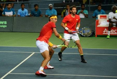 Spain's Rafael Nadal (L) and Marc Lopez play against India's Leander Peas and Saketh Myneni during their doubles tennis match during the Davis Cup World Group playoffs between Spain and India in New Delhi on September 17, 2016. AFP/Sajjad Hussain
