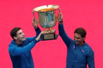 Tennis - China Open men's double final - Beijing, China - 09/10/16. Spain's Pablo Carreno Busta and Rafael Nadal lift their trophy after winning against Jack Sock of the U.S. and Bernard Tomic of Australia. REUTERS/Thomas Peter