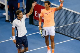 BEIJING, CHINA - OCTOBER 08: Rafael Nadal of Spian and Pablo Carreno Busta of Spain celebrate after winning against Mike Bryan of the United States and Bob Bryan of the United States during the Men's Double Semi Final match on day eight of the 2016 China Open at the China National Tennis Centre on October 8, 2016 in Beijing, China. (Photo by Etienne Oliveau/Getty Images)