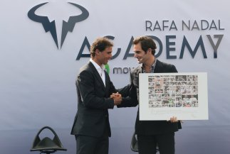Switzerland's Roger Federer holds a gift given by Spain's Rafael Nadal during the opening ceremony of the Rafa Nadal tennis academy in Manacor, Spain, October 19, 2016. REUTERS/Enrique Calvo