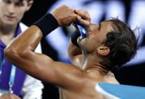 Spain's Rafael Nadal takes a snack during a break in his semifinal against Bulgaria's Grigor Dimitrov at the Australian Open tennis championships in Melbourne, Australia, Friday, Jan. 27, 2017. (AP Photo/Kin Cheung)