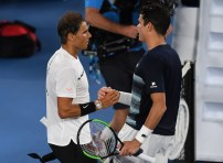 Spain's Rafael Nadal (L) shakes hands with Canada's Milos Raonic after winning their men's singles quarter-final match on day ten of the Australian Open tennis tournament in Melbourne on January 25, 2017. / AFP / GREG WOOD / IMAGE RESTRICTED TO EDITORIAL USE - STRICTLY NO COMMERCIAL USE (Jan. 24, 2017 - Source: AFP)