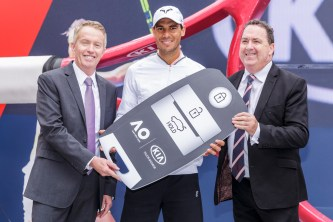 Chief Executive Officer of Tennis Australia Craig Tiley, Rafael Nadal of Spain and Chief Operations Officer of KIA Motors Australia Damien Meredith pose during a Kia Key handover ceremony at Garden Square in Melbourne Park January 15, 2017 in Melbourne, Australia. (Jan. 14, 2017 - Source: Daniel Pockett/Getty Images AsiaPac)