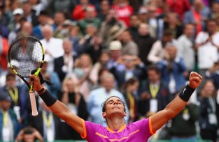 Rafael Nadal of Spain celebrates to the crowd after his three set victory against Kyle Edmund of Great Britain in their second round match on day four of the Monte Carlo Rolex Masters at Monte-Carlo Sporting Club on April 19, 2017 in Monte-Carlo, Monaco. (April 18, 2017 - Source: Clive Brunskill/Getty Images Europe)