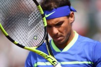 Spain's Rafael Nadal holds his racket during his tennis match against Netherlands' Robin Haase at the Roland Garros 2017 French Open on May 31, 2017 in Paris. / AFP PHOTO / Eric FEFERBERG (May 30, 2017 - Source: AFP)