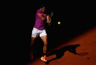 Rafael Nadal of Spain in action against Novak Djokovic of Serbia in the semi finals during day eight of the Mutua Madrid Open tennis at La Caja Magica on May 13, 2017 in Madrid, Spain. (May 12, 2017 - Source: Julian Finney/Getty Images Europe)