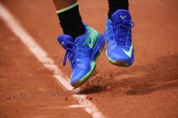 Spain's Rafael Nadal's shoes are pictures as he serves to France's Benoit Paire during their tennis match at the Roland Garros 2017 French Open on May 29, 2017 in Paris. / AFP PHOTO / Lionel BONAVENTURE (May 28, 2017 - Source: AFP)