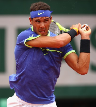 Rafael Nadal of Spain plays a backhand during the mens singles first round match against Benoit Paire of France on day two of the 2017 French Open at Roland Garros on May 29, 2017 in Paris, France. (May 28, 2017 - Source: Clive Brunskill/Getty Images Europe)