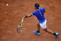 Spain's Rafael Nadal returns the ball to Georgia's Nikoloz Basilashvili during their tennis match at the Roland Garros 2017 French Open on June 2, 2017 in Paris. / AFP PHOTO / CHRISTOPHE SIMON (June 1, 2017 - Source: AFP)