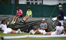 Spain's Rafael Nadal (3R) takes a break during a practice session at The All England Lawn Tennis Club in Wimbledon, southwest London, on July 4, 2017 on the second day of the 2017 Wimbledon Championships. / AFP PHOTO / Oli SCARFF / RESTRICTED TO EDITORIAL USE (Photo credit should read OLI SCARFF/AFP/Getty Images)