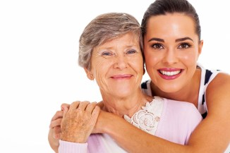 happy senior mother and adult daughter closeup portrait on white
