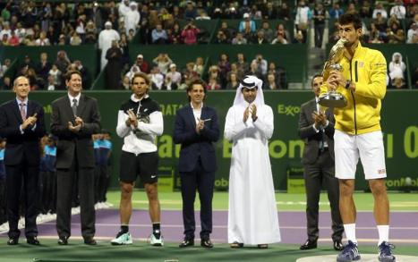 rafael-nadal-and-novak-djokovic-pose-with-their-trophies-after-their-match-in-doha
