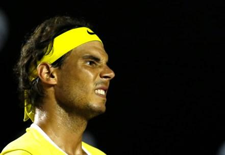 Rafael Nadal of Spain reacts to losing a point in a match against Pablo Carreno of Spain, at the Rio Open tennis tournament, in Rio de Janeiro, Brazil, Tuesday, Feb. 16, 2016. (AP Photo/Silvia Izquierdo)