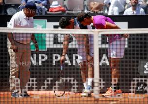 Tennis - ATP - Rome Open - Rafael Nadal of Spain v Nicolas Almagro of Spain - Rome, Italy - 17/5/17 - Nadal talks with Almagro as he touches his knee following an injury. REUTERS/Max Rossi