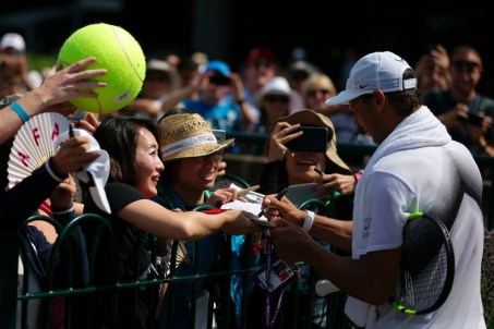 Spain's Rafael Nadal signs autographs after a practice session on the fourth day of the 2017 Wimbledon Championships at The All England Lawn Tennis Club in Wimbledon, southwest London, on July 6, 2017. / AFP PHOTO / Daniel LEAL-OLIVAS / RESTRICTED TO EDITORIAL USE (Photo credit should read DANIEL LEAL-OLIVAS/AFP/Getty Images)