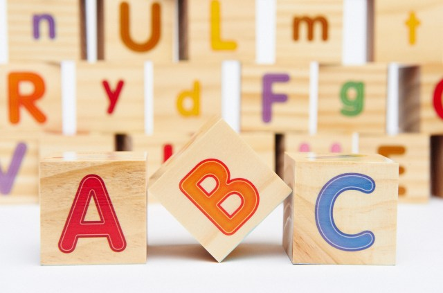 Spelling blocks toys with ABC in the foreground