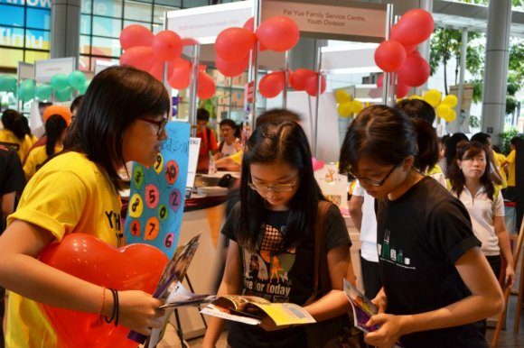 Visitors learning more about a VWO at Youth Got Heart 2012.