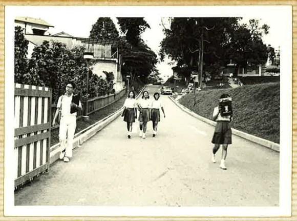 Mr Chan (left) leaving the Grange Road campus via its Kay Poh gate