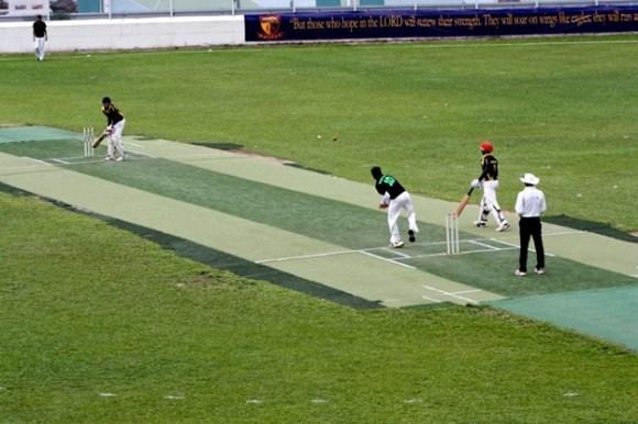 Vaikunth Seshadri bowls a ball