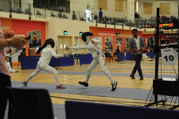 Raffles Institution's Chloe Chu lunges forward to score.