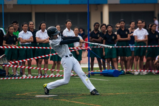 Jonathan Chua swinging at a ball