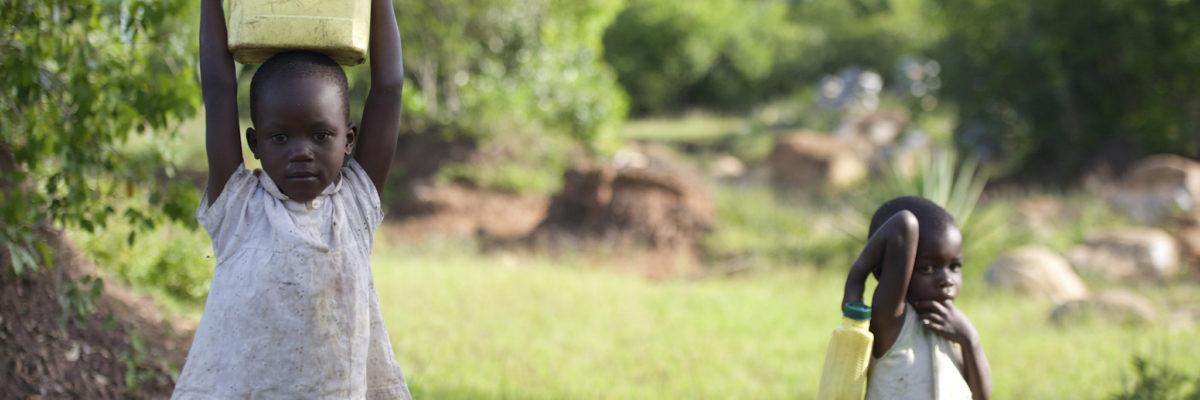 Children Carrying Water in Kenya Africa