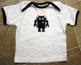 The original Giant Robot pattern, the red and black robots, are featured on a few different baby sized garments! Baby clothes with Giant Robot character patterns including an angry robot and smiley robot. Designed originally by Eric Nakamura in 1994, when his magazine was founded. Sizes range from 6-months to 3T. $20-35.