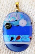 Surprise that special someone with a striking blue dichroic glass pendant from Yoko Matsubayashi of Garden Grove. (Courtesy of yokostar.com)