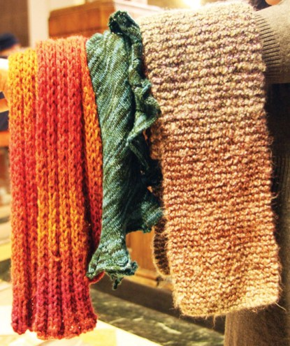 Naomi loves handmade scarves; the scarf on the right is the one her mother knit for her.