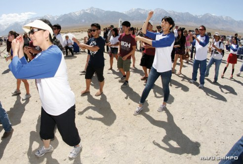 """Members of the Florin Japanese American Citizens League join in dancing """"Tanko Bushi"""" at the end of the pilgrimage."""