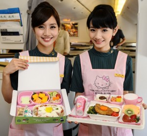 Flight attendants show off children's and Elite Class meals.