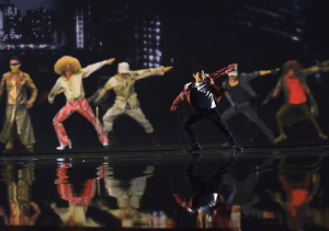 Kenichi Ebina danced with several digital characters, all played by him. (NBC)