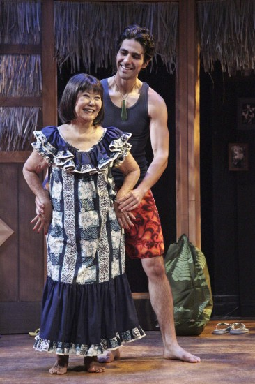 """Takayo Fischer as Sumi and Tui Asau as Kimo practice """"lovely hula hands."""" (Photo by Michael Lamont)"""