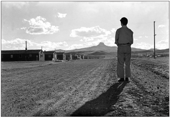Standing in the photo is spring 1944 Heart Mountain High School ASB President Kunio Yamamoto, whose family lived in Los Angeles and was sent to the Pomona Assembly Center prior to being sent to Wyoming. Courtesy of Washington State University Libraries MASC